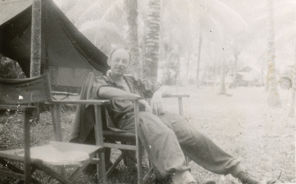 War Correspondent W.E. Pidgeon (WEP) relaxing in camp at Labuan