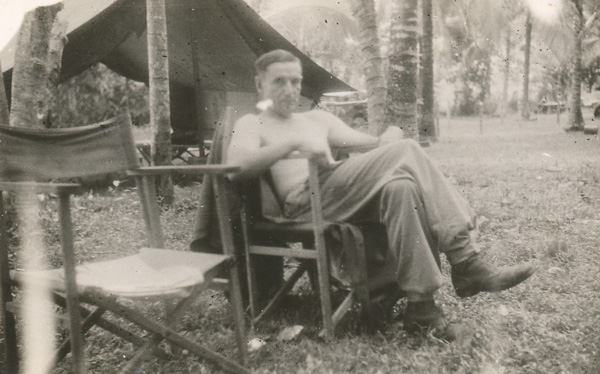 War Correspondent relaxing in camp at Labuan