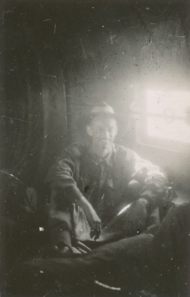 Wep sitting amongst the mail bags on a Douglas C47 transport pla