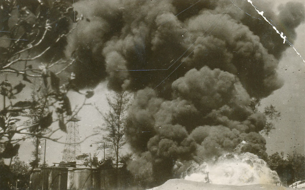 Oil wells at Seria set alight by the Japanese before departing