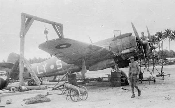 Ground crew performing maintenance on a Bristol Beaufighter of R