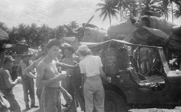 Ground crew at Morotai airfield take a refreshment break courtes