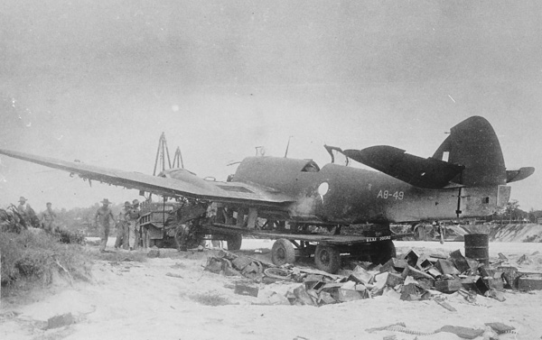 Wrecked Beaufighter A8-49 being salvaged for parts at Morotai ai