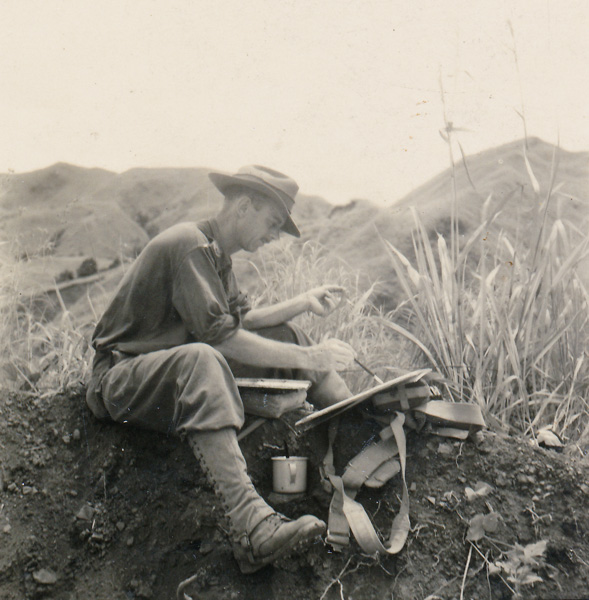 W.E. Pidgeon (WEP) at work in New Guinea near Rouna Falls, Port